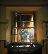 The light shines through the simple sash square headed window of Réidh Reamhar (Reyrawer) National School, Reyrawer townland, Co. Galway. This school house, built in 1883 is located high in the Slieve Aughty Mountains in Co. Galway. It is reported as the highest school house in Ireland