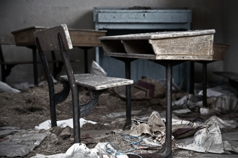 An empty school desk in an empty school