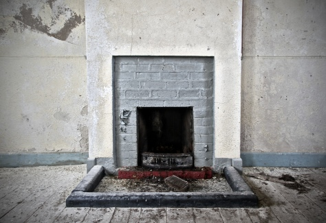 The simple fireplace inside the classroom that kept the schoolmaster and pupils warm in the winter months