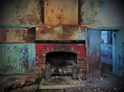 Plate 34 – The brightly coloured fireplace inside one of the classrooms of Ballycastle National School, Carrowkibbock Upper townland, Co. Mayo
