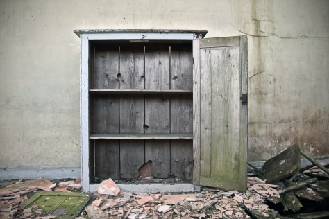 An old cupboard on the disintegrating floor of Brockagh National School