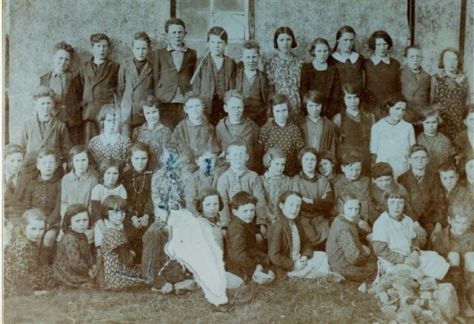 The school children of Kilnaboy National School gathered outsiThe old post office (X-PO) in Kilnaboy in 1932.